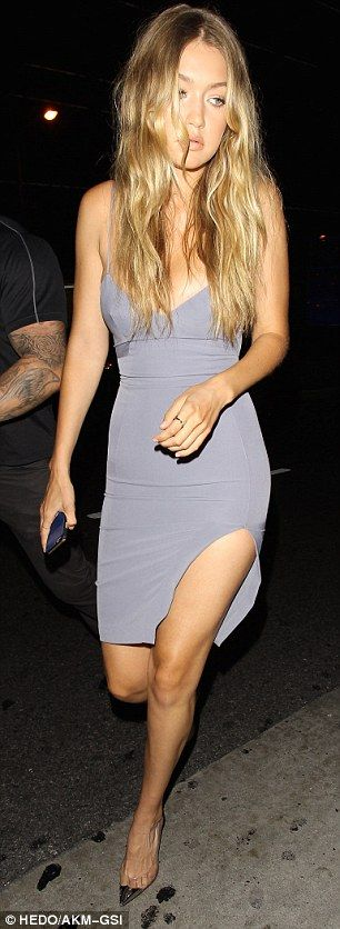 Leggy: The 20-year-old model showed off her incredible figure in the lowcut grey number, w...