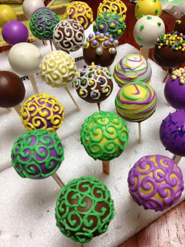 oh my goodness, we could make a bunch of mardi gras cake pops and hand them out as we walk through the crowd. Pulling them off the side of the float or something. hahah!