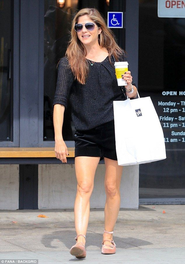 Pink lady: Selma Blair showed off her toned legs in a pair of velvet short and blush balle...