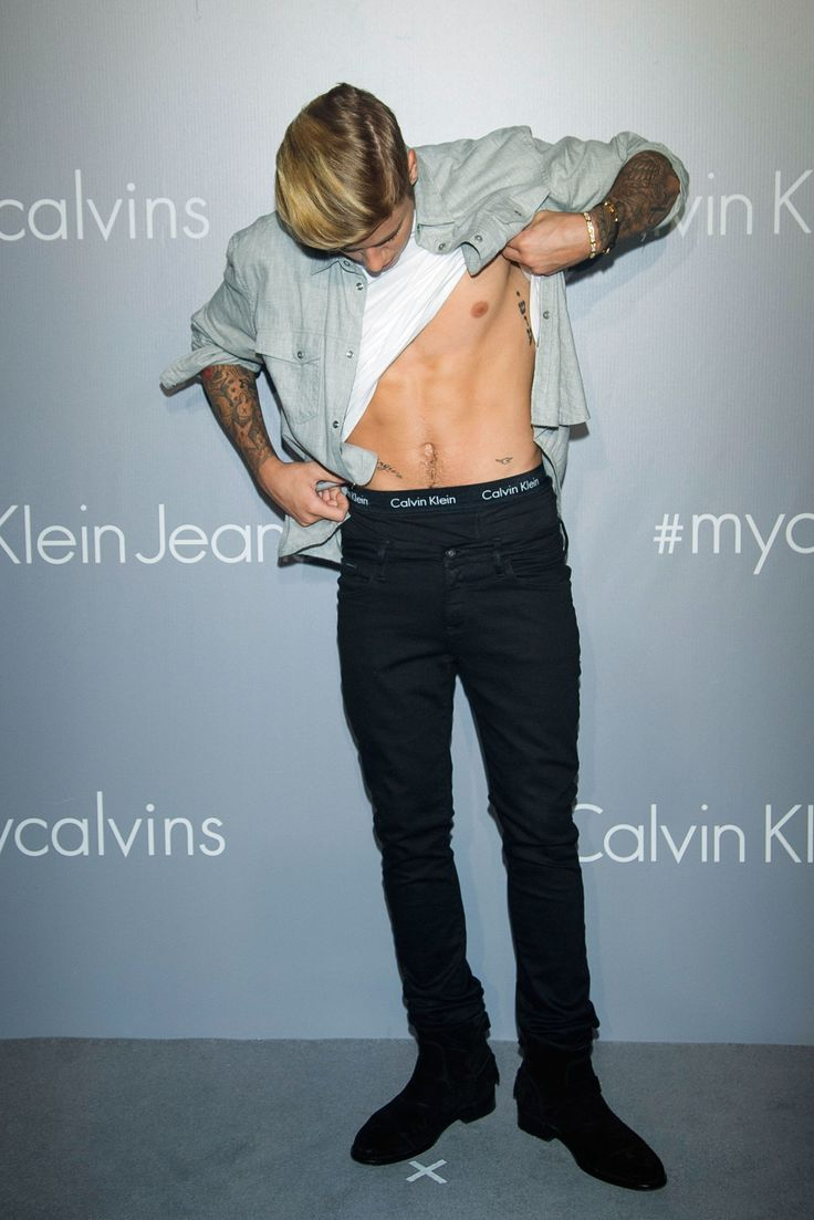 Justin Bieber poses on the red carpet at the Calvin Klein Jeans music event at the Kai Tak Cruise Terminal in Hong Kong on June 11, 2015. - Cosmopolitan.com