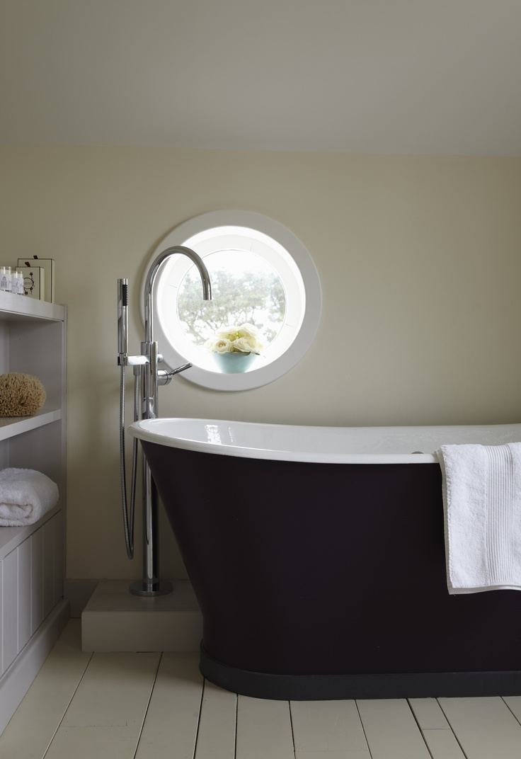 Wall in Farrow & Ball's White Tie,  skirting boards and floor in Cornforth White and bath in Pelt Estate Eggshell.