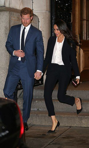 Meghan looked radiant in a black Alexander McQueen suit, a white blouse and sky-high Manolo Blahnik suede pumps. She and fiance Prince Harry held hands as they excited the Endeavour Fund Awards. Photo: © Getty Images
