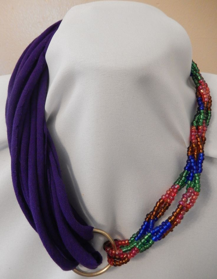 Half rope style t-shirt, half beaded necklace with ring.