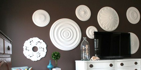 Bedroom wall idea - Inexpensive ceiling medallions from Lowe's or Home Depot for walls, painted whatever color I want.
