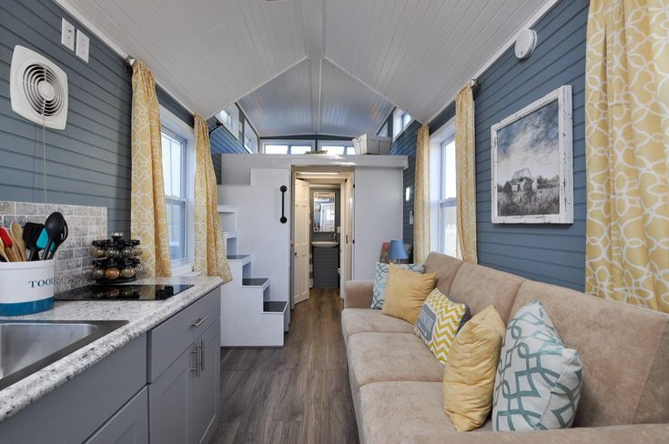 """This is the 24ft Laurel Tiny House on Wheels by Tiny House Building Company out of Fredericksburg, Virginia. It features about 272 sq. ft. of space inside and features an oversized 33"""" drop in stai…"""