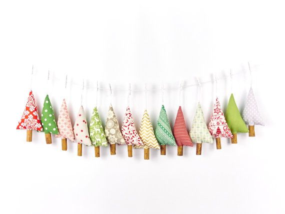 Add a dash of spice to your holiday decor with these primitive Christmas tree ornaments, made from a Fair Isle style fabric with fragrant cinnamon sticks for tree trunks. Each tree measures 14 cm (5 1/2 in) from the tip to the bottom of the trunk, 8 cm (just over 3 in) wide and is around 2cm (3/4 in) deep.  The trees are stuffed with fibre fill and have satin ribbon loops at the top for hanging. The trunks are sticks of top quality culinary grade cinnamon with a wonderful scent ... they do…