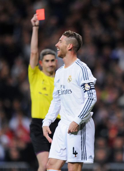 Sergio Ramos of Real Madrid is shown the red card by referee Alberto Undiano Mallenco during the La Liga match between Real Madrid CF and FC Barcelona at the Bernabeu on March 23, 2014 in Madrid, Spain.