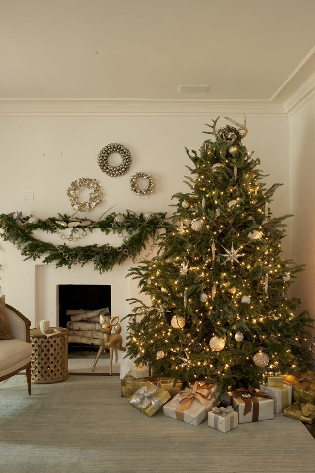 Decorating A Christmas Tree In White And Silver