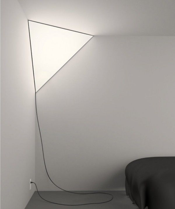 A unique light source. The lamp lives in the corner of a room, creating a glowing triangle that seems to blend-in and stand-out simultaneously.