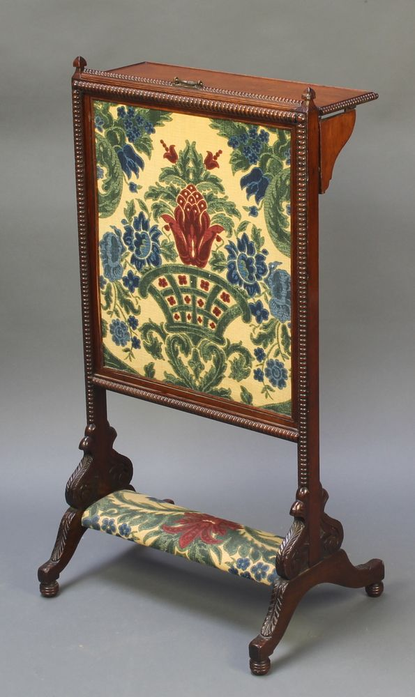"""Lot 1030, A Victorian carved rosewood adjustable fire screen fitted a folding shelf and with tapestry panel to the centre 32""""h x 17""""w x 12""""d, est £100-150"""
