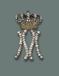 A LADY-IN-WAITING BADGE FOR QUEEN MARIA JOSE OF ITALY, BY MUSY. Designed as a diamond-set initial 'M' surmounted by a crown, mounted in silver and gold, circa 1930.