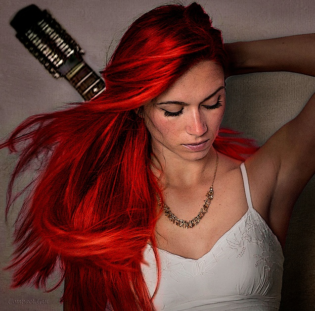 long blood red hair, musical instrument...YES.