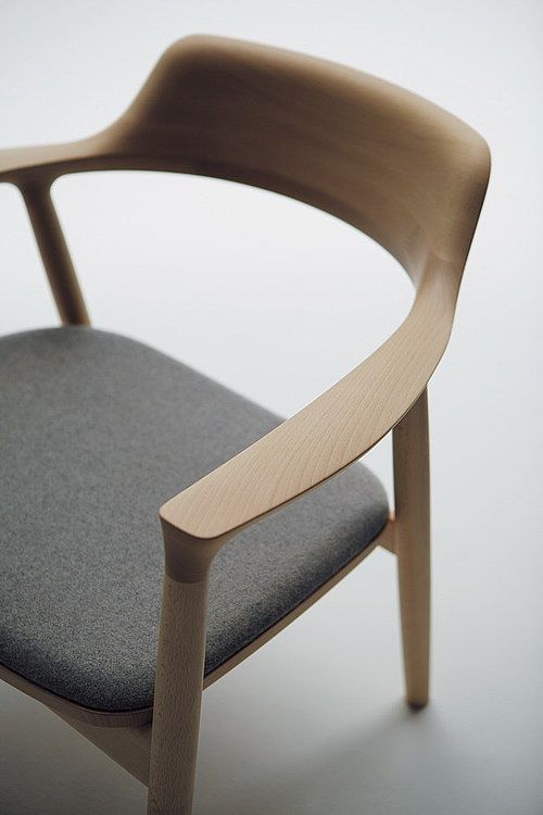 Chair for each end of dining table in black leather. Hiroshima by Naoto Fukasawa for Maruni