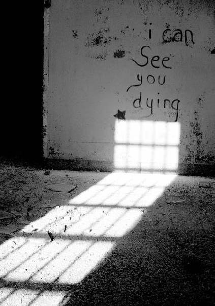 Kings Park Psychiatric Center. Most likely this is graffiti that was written after the place was closed. Still creepy with the window light coming in and all.