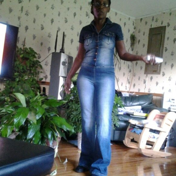 Blue jean jumpsuit. Blue jean jumpsuit. Back of the lower has cone shape pattern. Jeans are faded acid wash. Candie's Pants Jumpsuits & Rompers