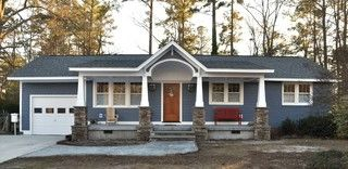 This is an interesting example of adding a front porch with stone to a rambler. Plus, I like this blue/periwinkle house color.