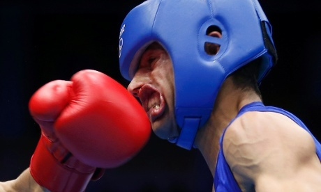 Hope he has his gum shield in. Nordine Oubaali of France (L) fights against Afghanistan's Ajmal Faisal in the men's Fly (52kg) Round of 32 boxing match.