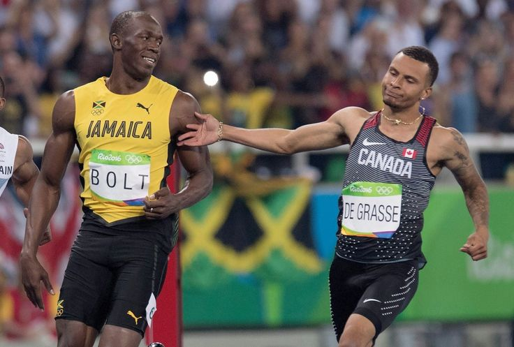 Canada's Andre De Grasse, right, gives Usain Bolt of Jamaica a playful tap on the arm following the men's 100-metre semifinal at the Olympic games in Rio de Janeiro, Brazil, on Sunday, August 14, 2016. THE CANADIAN PRESS/Frank Gunn