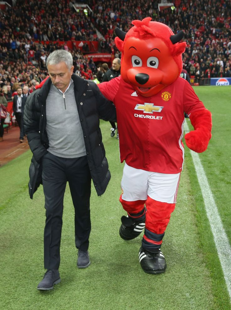 Manager Jose Mourinho of @manutd walks out with club mascot Fred the Red.