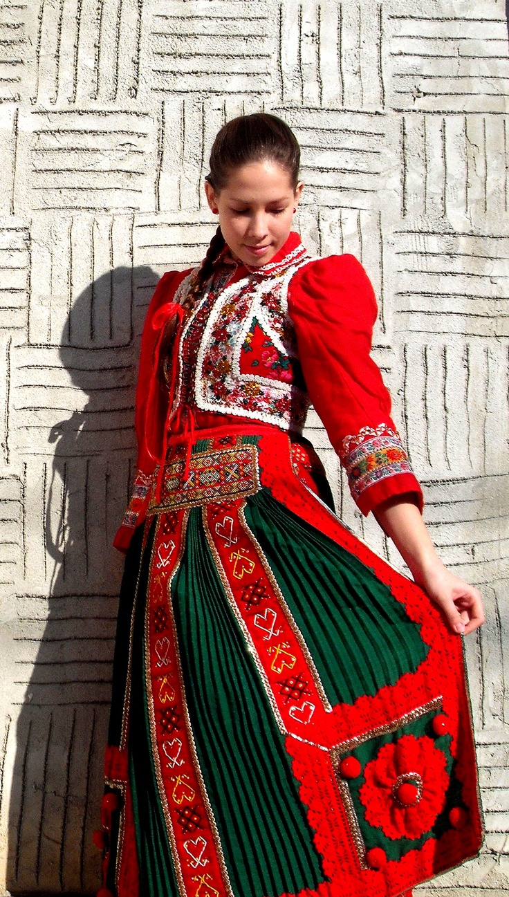 Folk dancer girl in traditional clothing of Kalotaszeg, Transylvania.