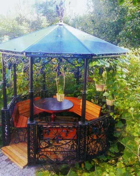 Hexagonal Gazebo Design With Wooden Benches