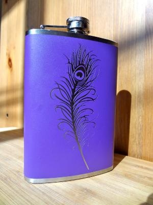 who wouldn't want a flask with a peacock feather? so awesome