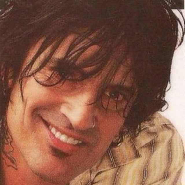Tommy Lee hot dark tattooed,   Well gotta say one of my favorite BAD BOYS!!!   I bet you would have never guessed that...