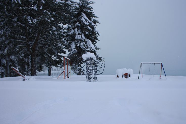 Lakefront playground surrounded by snow in Lake Tekapo mid winter