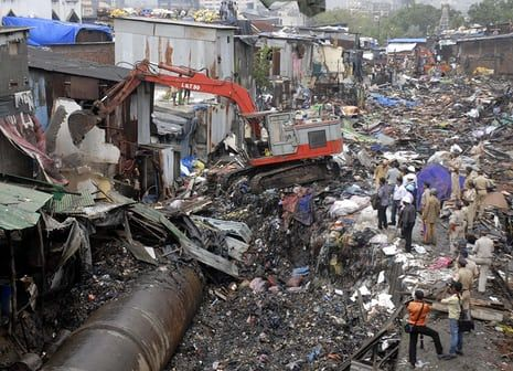 Illegal homes near the water pipeline are demolished in Dharavi.