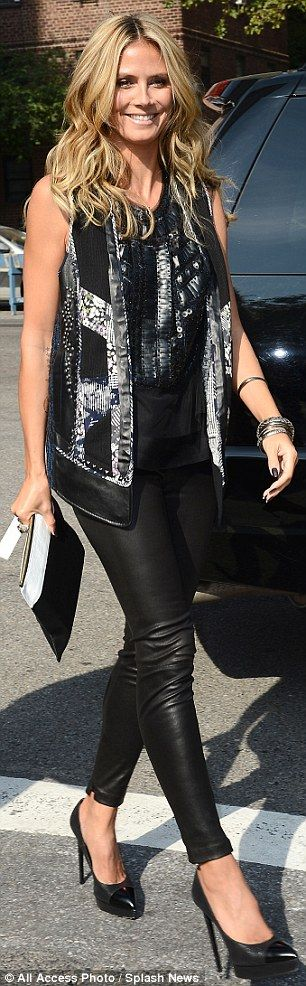 Upping the glitz: The mother-of-four looked incredible in the daring trousers, which she paired with a loose black top and sequined sleeveless jacket