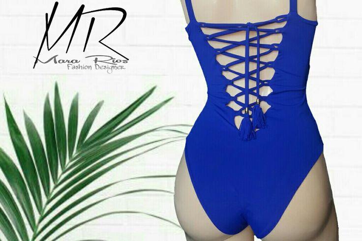 Swimsuit blue. Traje de baño entero escote en espalda, detalles en tiras