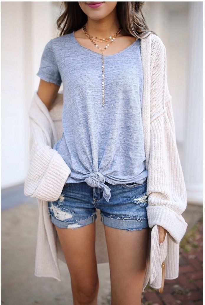 Light blue knotted tee with contrasting denim shorts
