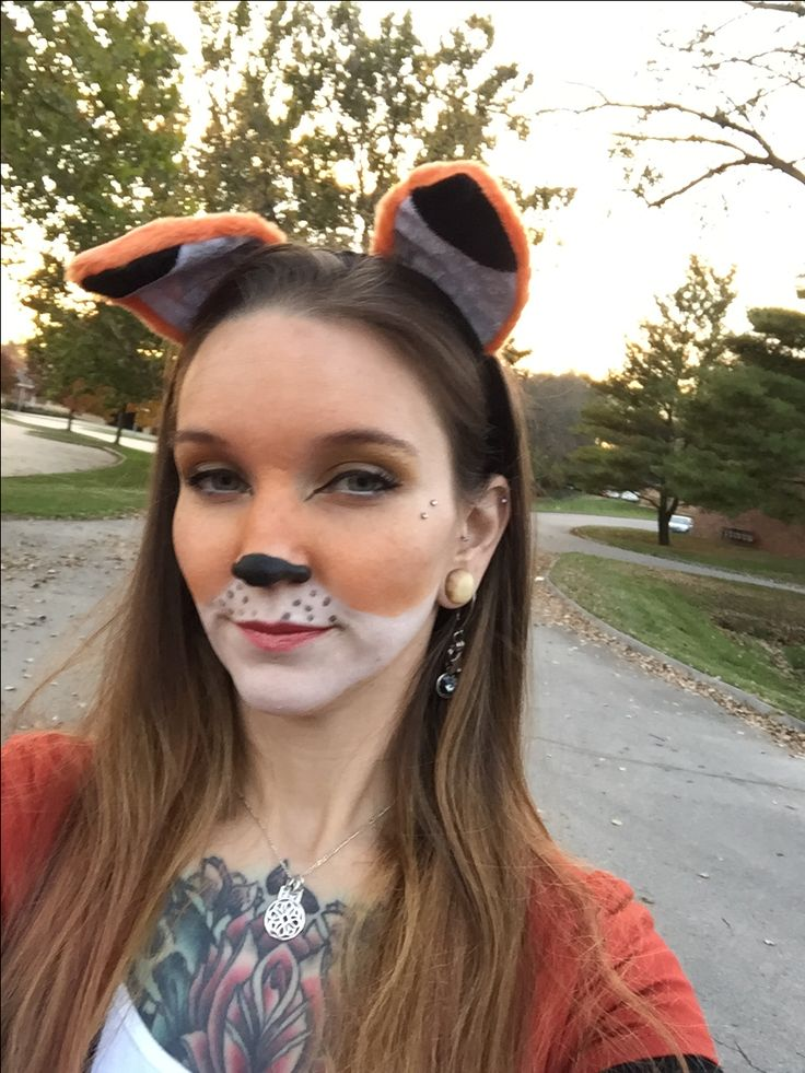 Fox Halloween make up. Done with white face paint and orange eye shadow.