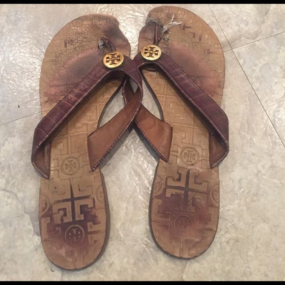 Authentic Tory Burch brown leather flip flops Authentic Tory Burch brown leather flip flops---very worn. They need a lot of work. The right foot thong needs to be fixed and the leather sole is worn down in places. They can easily fix thong and patches/solutions can be applied to worn areas. I've had other Tory Burch flip flops fixed before. Just had a hard time tossing these!! Tory Burch Shoes Sandals