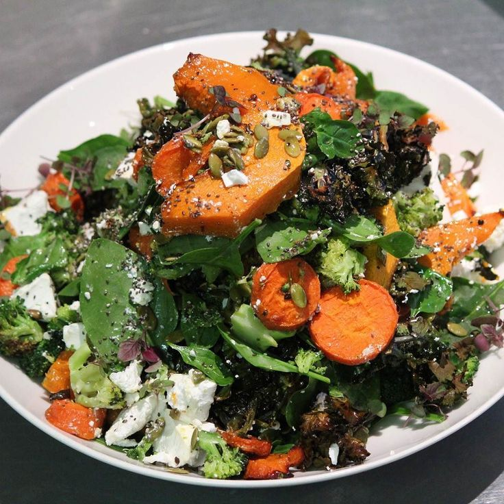 Todays Winter nourish salad - maple roasted pumpkin carrots and broccoli with Danish feta seeds crispy kalettes and shiso herbs
