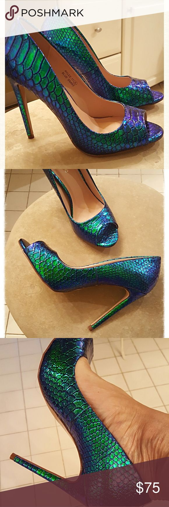 """REDUCED!💜💚TGIF SPECIAL!💜💚HOST PICK💚💜 These shoes are truly made for the High Heel Diva!💙 Iridescent hologram colors range from turquoise to purple. Heel is 4-3/4 """". They run 1/2 size small. NIB.💚 Price is firm.💜 Shoes Heels"""