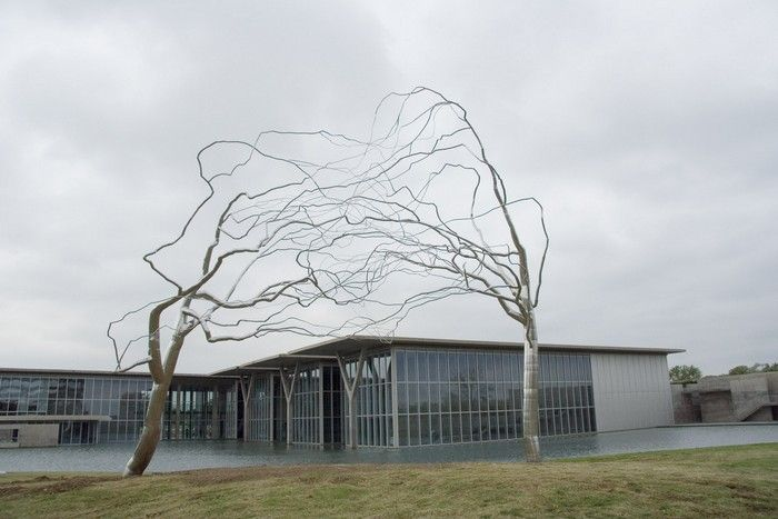 Roxy Paine is an artist that lives and works in New York, and gets inspired by Nature to create massive tree sculptures.