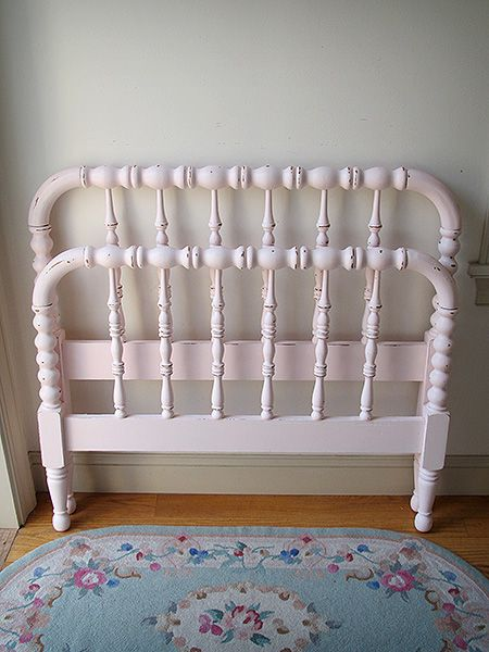 This pretty pink Jenny Lind style twin bed would look darling in a little girl's room. It is refinished a ballet pink and lightly distressed.