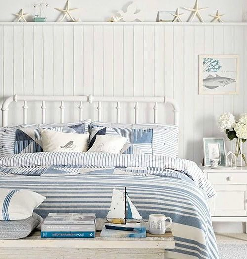 Coastal Bedroom With Metal Bed And Panelling
