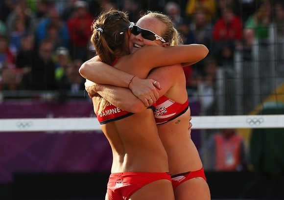 Zara Dampney and Shauna Mullin of Great Britain celebrate during the Women's Beach Volleyball Preliminary match between Great Britain and Canada on Day 2 of the London 2012 Olympic Games at Horse Guards Parade on July 29, 2012 in London, England. (Photo by Ryan Pierse/Getty Images)