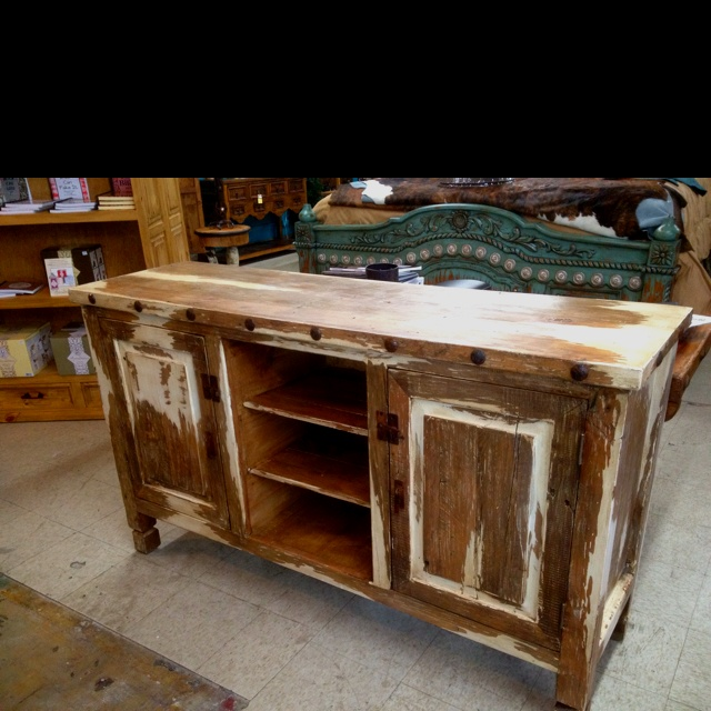 This antique white TV stand is one that people will talk about. It brings out the old and new. Awesome
