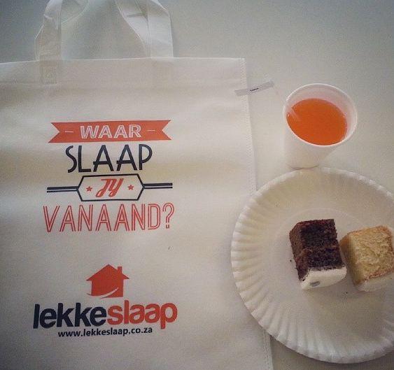 The TravelGround and LekkeSlaap teams celebrate LekkeSlaap's first birthday! Cake, fanta orange, and free bags for all! Happy Birthday LekkeSlaap :)