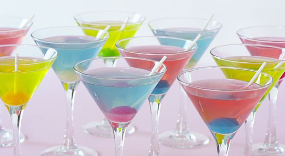 Blow Pop Martini (2/3 cup frozen lemonade concentrate, thawed and strained to remove solids  1 1/3 cups water  1 1/2 cup bubble-gum flavored vodka  4 tbsp sour apple, sour watermelon or berry blue sour liqueur  12  small lollipops, unwrapped, for garnish if desired)