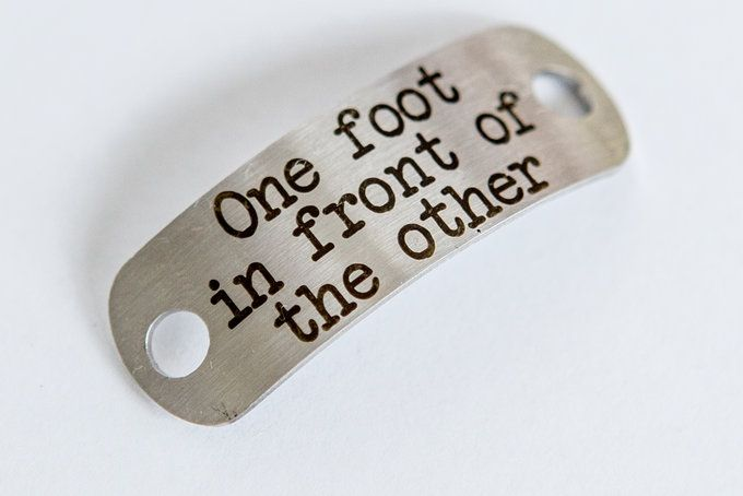One foot in front of the otherGive this motivational shoelace tag as a gift to somebody challenging their limits.