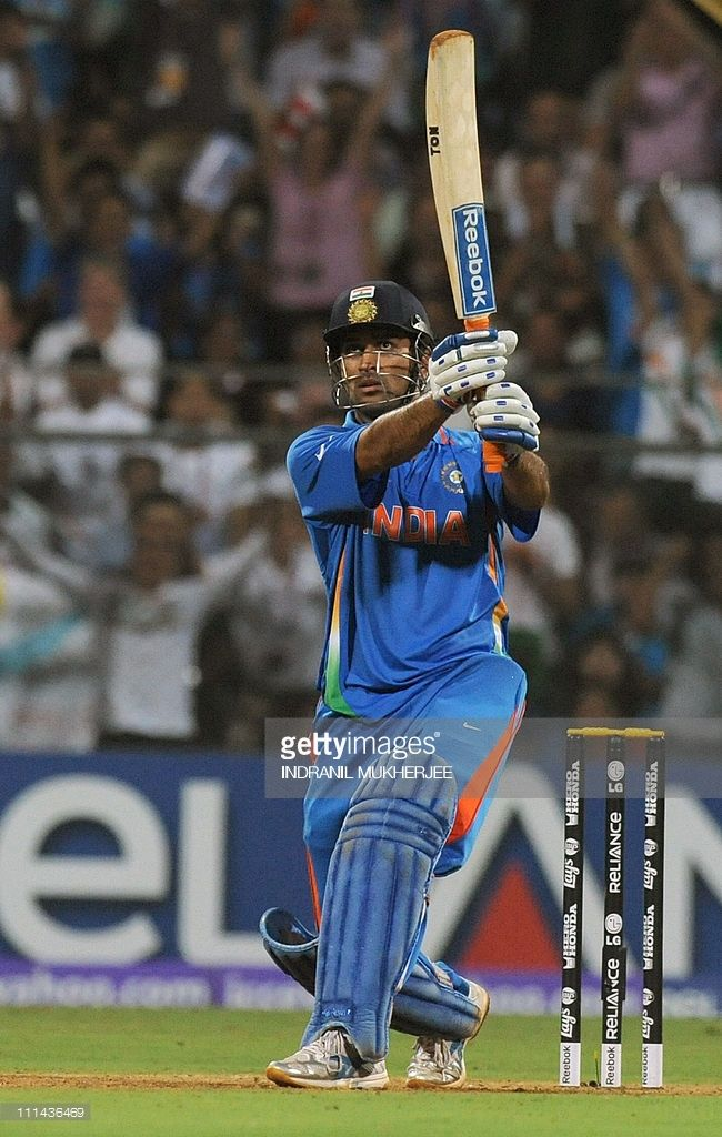 Indian Captain Mahendra Singh Dhoni Hits A Six To Win Against Sri Ms Dhoni Photos India Cricket Team Dhoni Wallpapers
