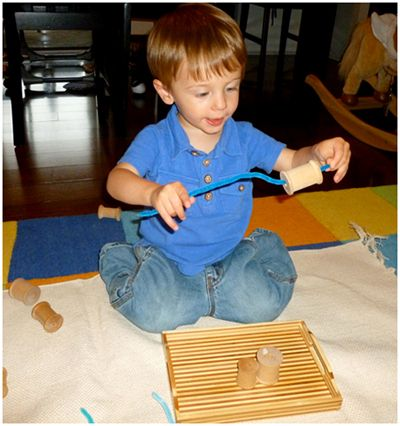 There are only two ways to live your life.: Montessori for 19 to 20 Month Olds - thread spools and pipe cleaners.