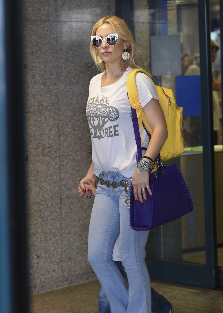 Eye spy Fendi Eyeshine! Kate Hudson arriving in Rome wearing a pair of Eyeshine sunglasses and her new Fendi Peekaboo bag.