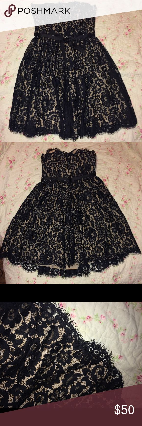 Elegant Black and Tan lace dress. Only worn once. But I don't have pictures with it on. Black and Tan lace dress with bra like clip on the inside to adjust the size. Also has a prettied ribbon that goes from each side of the zipper and ties in the front. Neiman Marcus Dresses