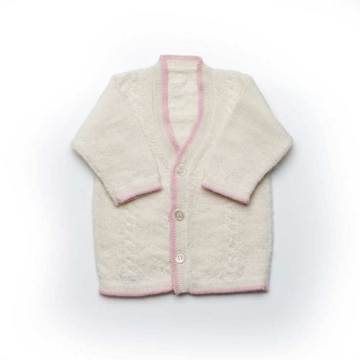 Our fabulously luxurious knitted cardigan with pink piping.