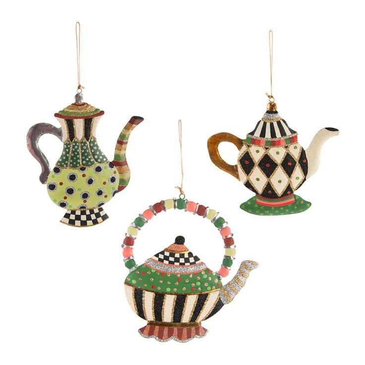 Three Wonderland Teapot tree decorations from Mackenzie-Childs. Handcrafted from tin, this set of three decorations are each shaped like different teapots.  Quirky Fun Christmas tree ornaments.